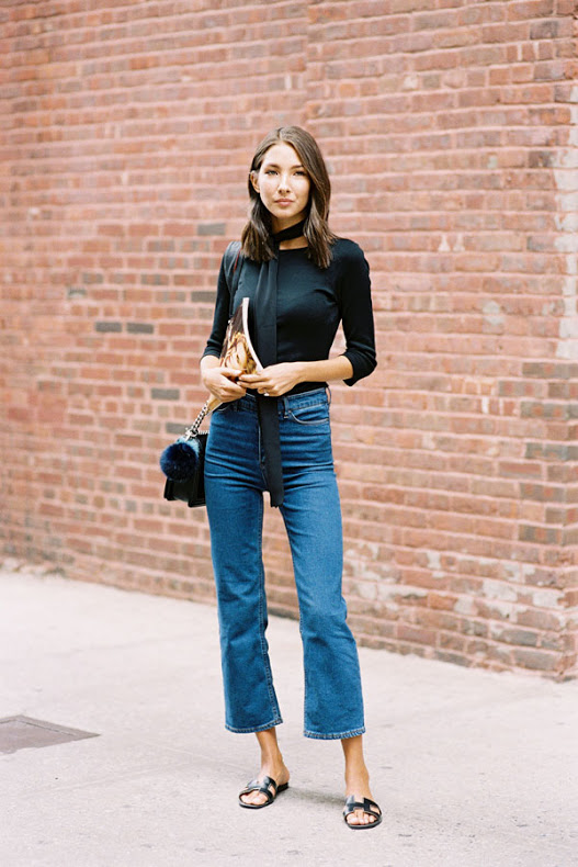 Black Top tucked into a flare jeans with sandals. (Source: Vanessa Jackman's Blog)